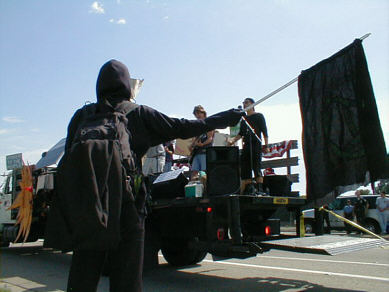 The Traitors play live on a flatbed truck, through a solar powered PA, in an anti-fraudulent energy crisis, anti-Bush demonstration, Long Beach CA, July 4, 2001 - CLICK FOR NEXT IMAGE